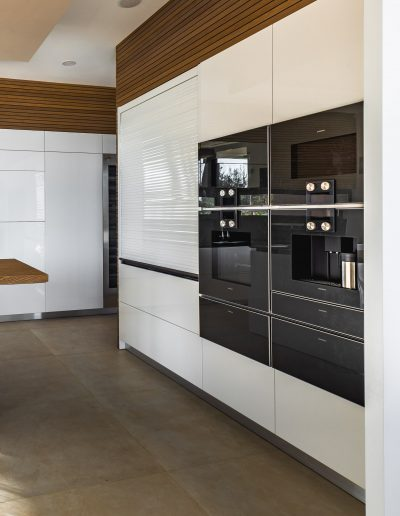 Handleless Kitchen columns with ovens, expresso machine, microwaves and warming drawers