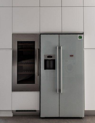 Modern handleless Kitchen with American fridge freezer and Wine Cellar