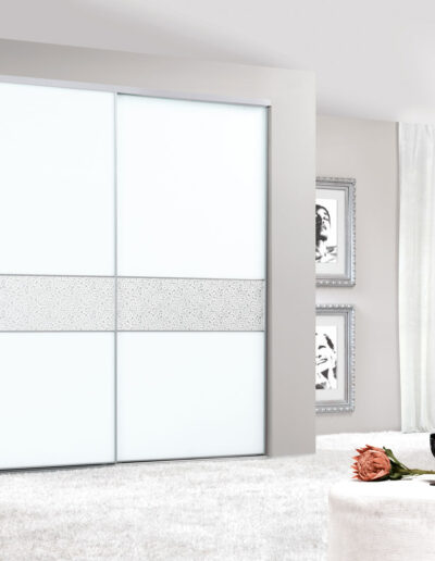 Sliding door closet with white lacquered doors.