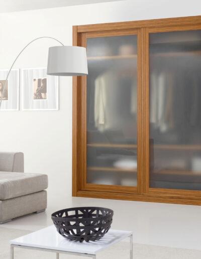Sliding door closet with frosted tempered glass and zebrano veneer doors.