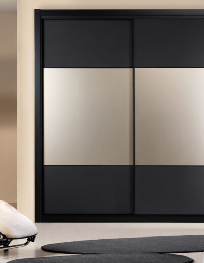 Sliding door closet with black frosted lacquered and bronze frosted doors.