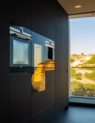 Oven, Wine cellar and expresso machine in Modern Black Kitchen in Algarve