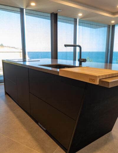 Island in Modern Black Kitchen in Algarve