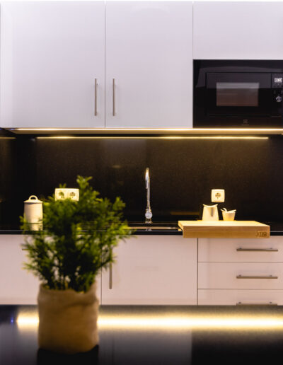 Detail of the LED light built-in in wall units of kitchen.
